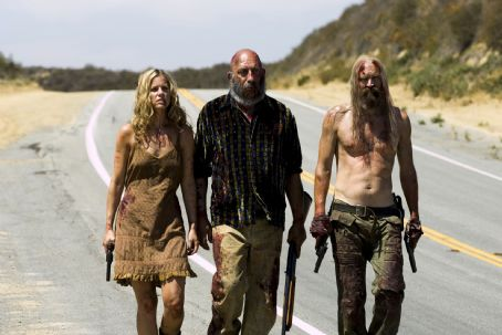 Sid Haig Sheri Moon Zombie (as Baby),  (as Capt. Spaulding) and Bill Moseley (as Otis Driftwood) in The Devil's Rejects. Photo credit: Gene Page