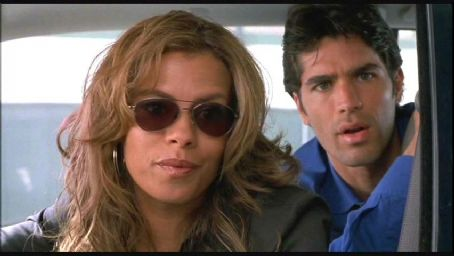 Lisa Vidal  as Carmen and Eduardo Verastegui as Thomas Fuentes in Linda Mendoza's CHASING PAPI, 20th Century Fox release. © 2003