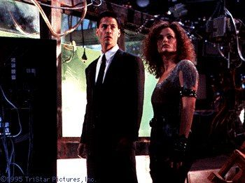 Dina Meyer Keanu Reeves and  in Johnny Mnemonic (1995)
