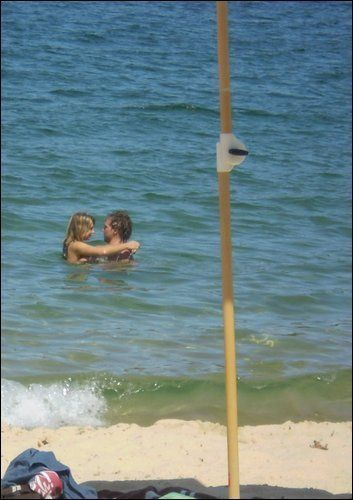 Indiana Evans candid pic of Indiana and Lincoln swimming together.