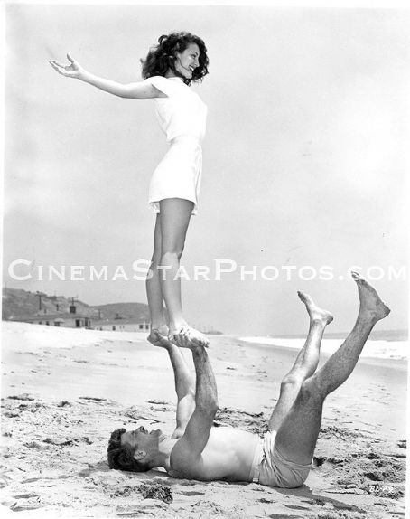 Burt Lancaster  and Ava Gardner playing at beach 1946 taking break from shooting of The Killers.