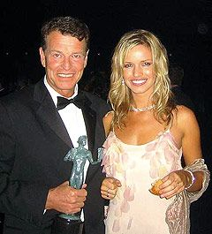 John Noble  and Penny Unknown