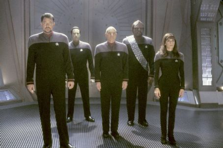 Jonathan Frakes  as Commander William T. Riker, Brent Spiner as Lieutenant Commander Data, Patrick Stewart as Captain Jean-Luc Picard, Michael Dorn as Lieutenant Commander Worf and Marina Sirtis as Counselor Deanna Troi in Paramount's Star Trek: Nemesi