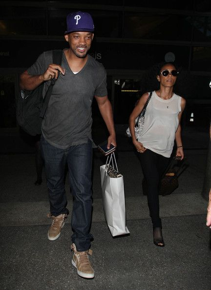Will Smith and his wife Jada Pinkett Smith arrived at the LAX Airport in Los Angeles, California on July 2, 2012
