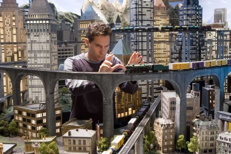 Bryan Singer Behind-the-Scenes, Director  sets up a shot involving an elaborate model train set. Photo by David James