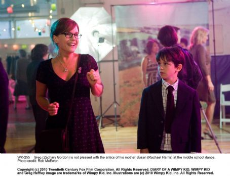Rachael Harris Greg (Zachary Gordon) is not pleased with the antics of his mother Susan () at the middle school dance. Photo credit: Rob McEwan.