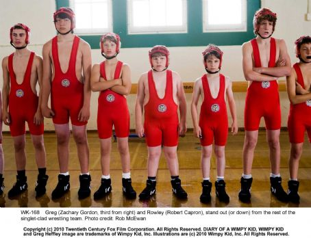 Diary of a Wimpy Kid Greg (Zachary Gordon, third from right) and Rowley (Robert Capron), stand out (or down) from the rest of the singlet-clad wrestling team. Photo credit: Rob McEwan