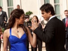 Damon Salvatore Nina Dobrev as Elena Gilbert and Ian Somerhalder as  in The Vampire Diaries (2010)