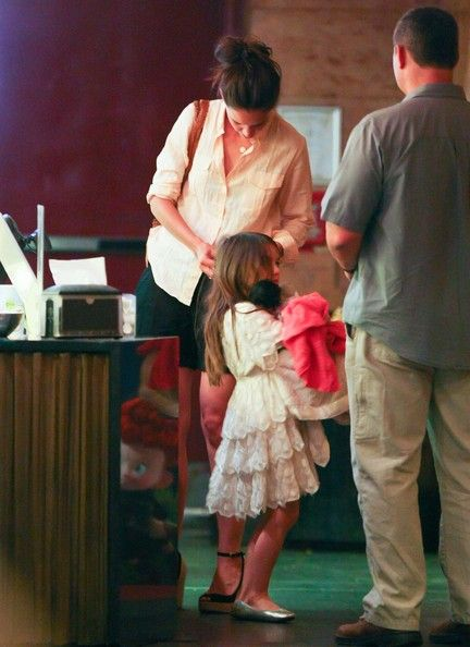 Katie Holmes and daughter Suri Cruise in New York, NY on June 23rd, 2012. Mom Katie paid with cash for Suri and her to see 'Brave'