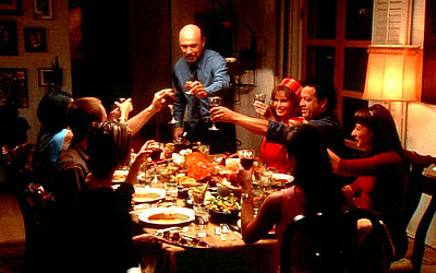 Constance Marie Patriarch Martin (Hector Elizondo) makes an announcement to his dinner guests (counter-clockwise from left) April (Marisabel Garcia), Yolanda (), Andy (Nikolai Kinski), Maribel (Tamara Mello), Carmen (Jacqueline Obradors), Leticia (Elizabet