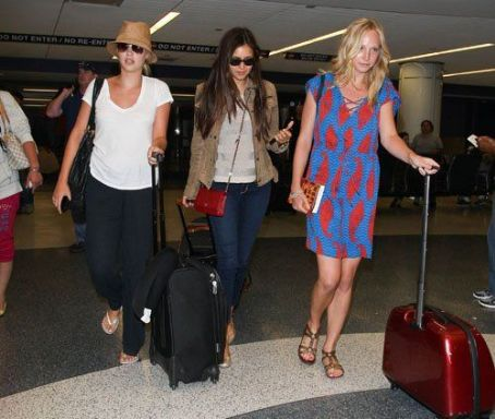 "Nina Dobrev - The stars of ""The Vampire Diaries"" arriving at the LAX Airport in Los Angeles, California (July 6)"