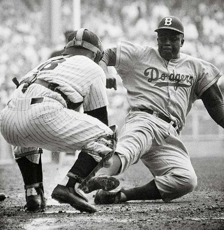 Jackie Robinson  stealing home against the N.Y. Yankees