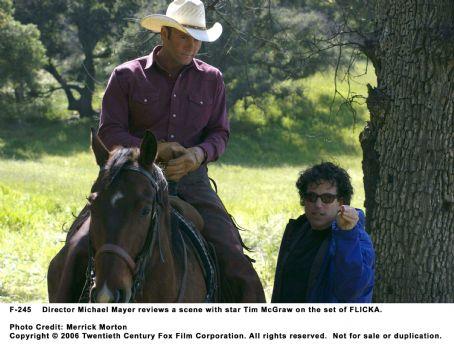 Michael Mayer Director  reviews a scene with star Tim McGraw on the set of FLICKA. Photo Credit: Merrick Morton. © 2006 Twentieth Century Fox.