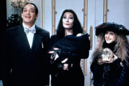 Morticia Addams Raul Julia, Anjelica Huston and Carol Kane in Addams Family Values (1993)