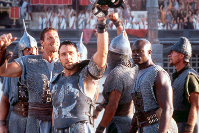 Ralf Moeller Gladiators Hagen (), Maximus (Russell Crowe) and Juba (Djimon Hounsou) in Dreamworks' Gladiator - 5/2000