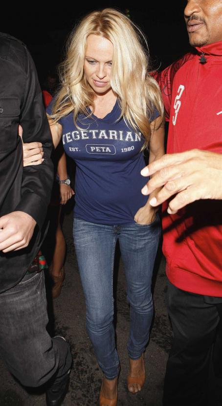 Pamela Anderson In Blue Top/jeans Headed To Premiere Nightclub In La-Oct 31 2010