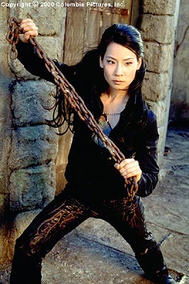 Charlie's Angels Lucy Liu as Alex, one of a trio of elite private investigators who is a barracuda in the boardroom, a terror in the trenches, and a disaster in the kitchen in Columbia's Charlie's Angels - 2000
