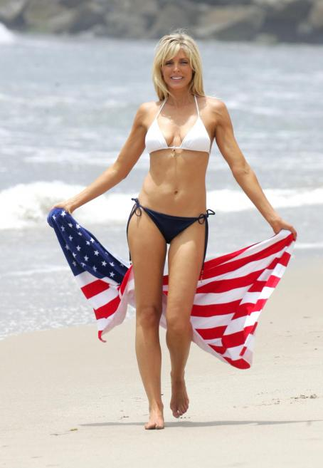 A Patriotic Marla Maples Gets Her Independence Day Celebrations Off To An Early Start. Out For Her Routine Morning Exercise, The Shapely Former Wife Of Donald Trump Skipped Across The Sand With A Stars And Stripes Towel, 2008-07-22