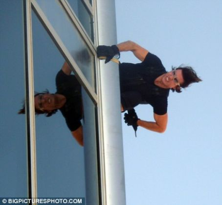 Sitting on top of the world! Tom Cruise performs death-defying stunt on world's highest skyscraper