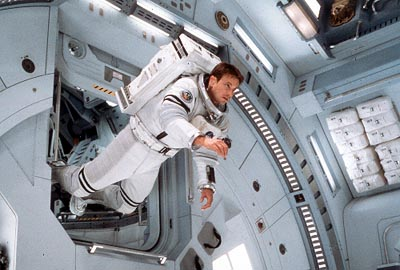 Jim McConnell (Gary Sinise) floats into the airlock area of the Mars Recovery mission craft in Touchstone's Mission To Mars - 2000