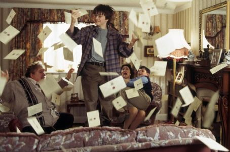 Fiona Shaw Daniel Radcliffe as Harry Potter being showered by letters as the Dursleys (left-to-right Richard Griffiths as Vernon,  as Petunia and Harry Melling as Dudley) panic in Warner Brothers' Harry Potter and The Sorcerer's Stone - 2001