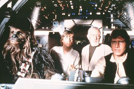 Peter Mayhew Mark Hamill as Luke Skywalker,Alec Guinness as Obi Wan Kenobi, as Chewbacca and Harrison Ford as Han Solo in Star Wars: A New Hope (1977).