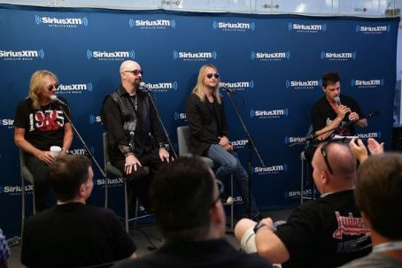 Jim Breuer Glenn Tipton, Rob Halford and Richie Faulkner of the band Judas Priest along with host  attend SiriusXM's Town Hall series with Judas Priest on July 8, 2014 in New York City