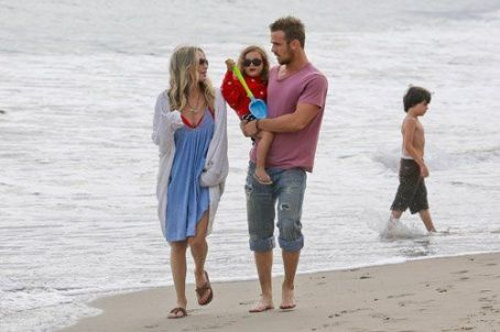 Cam Gigandet with his wife Dominique Geisendorff and their daughter Everleigh Ray on the beach in Malibu, CA (July 4)