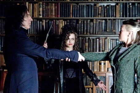 Severus Snape (L-r) ALAN RICKMAN as , HELENA BONHAM CARTER as Bellatrix Lestrange and HELEN McCRORY as Narcissa Malfoy in Warner Bros. Pictures' fantasy 'Harry Potter and the Half-Blood Prince.' Photo by Jaap Buitendijk