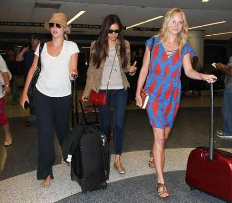 "Candice Accola - The stars of ""The Vampire Diaries"" arriving at the LAX Airport in Los Angeles, California (July 6)"