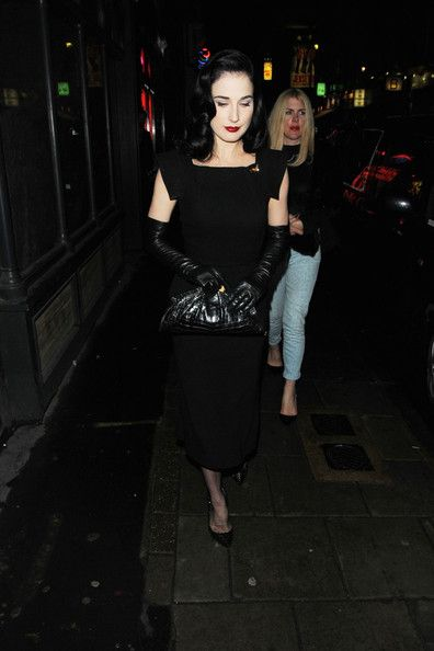 Dita Von Teese is seen gracefully leaving La Bodega Negra Soho's newest trendy restaurant in London