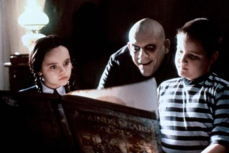 Wednesday Addams Christopher Lloyd, Christina Ricci and Jimmy Workman in The Addams Family (1991)