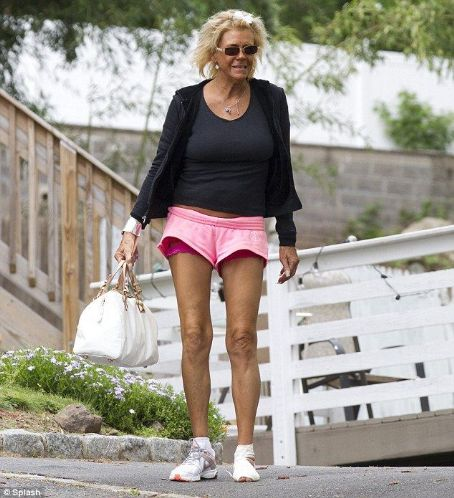 Patricia Krentcil Standing out: , known as Tanning Mom after she allegedly took her five-year-old daughter to a tanning booth, is seen outside her home on Monday - flashing her lacy pink underwear