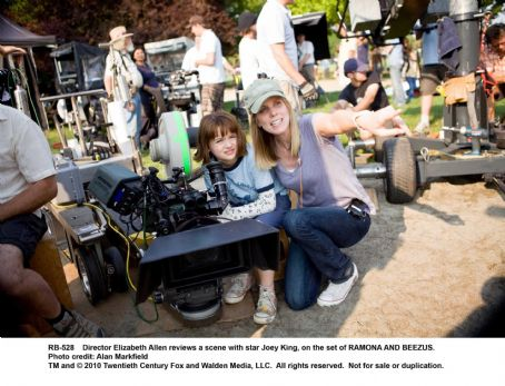 Director Elizabeth Allen reviews a scene with star Joey King, on the set of RAMONA AND BEEZUS. Photo credit: Alan Markfield