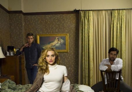 Danny Pino Mike Vogel as Julian, Brittany Murphy as June and  as Terry in Image Entertainment thriller 'Across the Hall.'