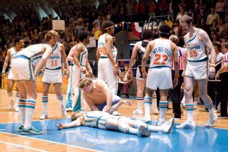 "Andy Richter Woody Harrelson (left) stars as ""Ed Monix"",  (center) as the Tropic's manager ""Bobby Dee"", Will Ferrell (center floor) as an unconscious ""Jackie Moon"" and Peter Cornell (right) as ""Vakidis"""