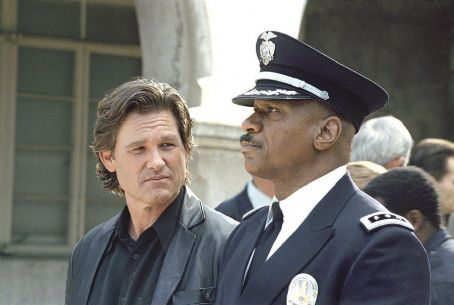 Kurt Russell and Ving Rhames star as Eldon Perry and Arthur Holland