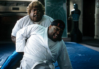 Big Momma (Martin Lawrence) gives Nolan (Anthony Anderson) a lesson in proper martial arts technique in 20th Century Fox's Big Momma's House - 2000