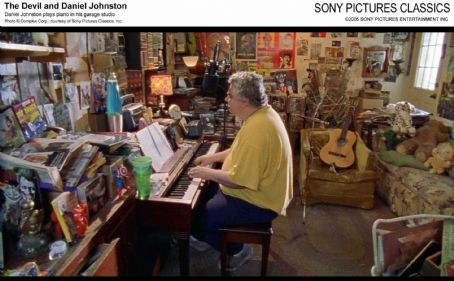 Daniel Johnston plays piano in his garage studio. Photo © Complex Corp., courtesy of Sony Pictures Classics, Inc.