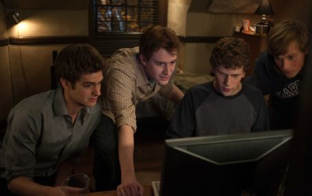 Eduardo Saverin L-r, Andrew Garfield, Joseph Mazzello, Jesse Eisenberg and Patrick Maple in Columbia Pictures' 'The Social Network.' Photo By: Merrick Morton
