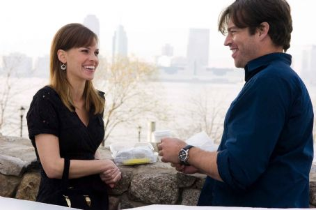 "P.S. I Love You HILARY SWANK as Holly Kennedy and HARRY CONNICK, JR. as Daniel in Alcon Entertainment's romantic drama "","" distributed by Warner Bros. Pictures. The film also stars Gerard Butler. Photo by Phil Caruso. TM & © 2007 Warner B"