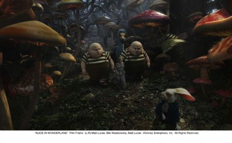 Matt Lucas  as Tweedledee / Tweedledum and Mia Wasikowska as Alice Kingsley in ALICE IN WONDERLAND. © Disney Enterprises, Inc. All rights reserved.