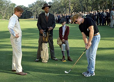 J. Michael Moncrief Director Robert Redford demonstrates a golf swing for Matt Damon, Will Smith and  on the set of Dreamworks' The Legend of Bagger Vance - 2000