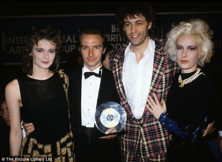 Midge Ure Annabel Giles, , Bob Geldof and Paula Yates with a special award for Band Aid at the 1985 Brit Awards