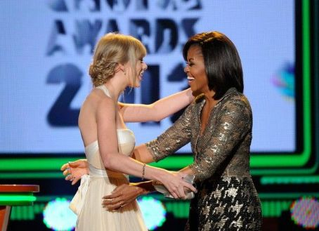 First Lady Michelle Obama presents the Big Help award onstage at Nickelodeon's 25th Annual Kids' Choice Awards held at Galen Center on March 31, 2012 in Los Angeles