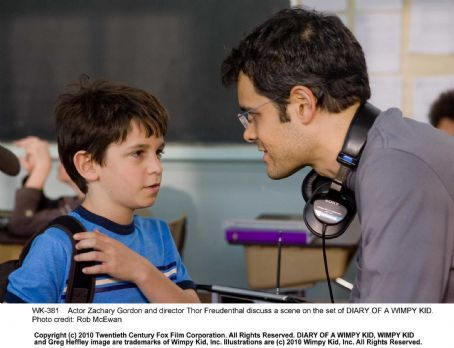Diary of a Wimpy Kid Actor Zachary Gordon and director Thor Freudenthal discuss a scene on the set of DIARY OF A WIMPY KID. Photo credit: Rob McEwan