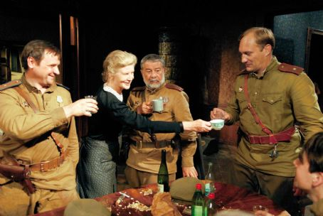 Evgeniy Sidikhin Irm Hermann as Witwe (between_soldiers) and Evgeny Sidikhin as Major Andreij Rybkin (far right) in the scene of A Woman in Berlin.