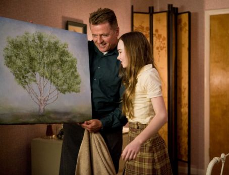 Flipped (L-r) AIDAN QUINN as Richard Baker and MADELINE CARROLL as Juli Baker in Castle Rock Entertainment's coming-of-age romantic comedy 'FLIPPED,' a Warner Bros. Pictures release. Photo by Ben Glass